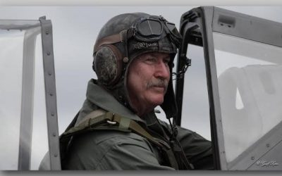 Frank sitting in war birds plane